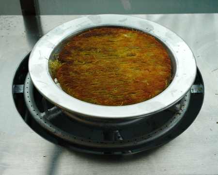 Gazianteps famous crispy kunefe (künefe). Traditional turkish arabic dessert. Turkish flavor with pistachio. Stok Fotoğraf