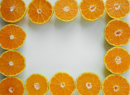 tangerine fruit frame. Top view. Free space for text. Satsuma Mandarins fruit background