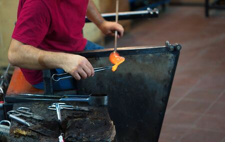 glass blowing art. Glass artist, are created by inserting the glass objects form Banco de Imagens - 132213006