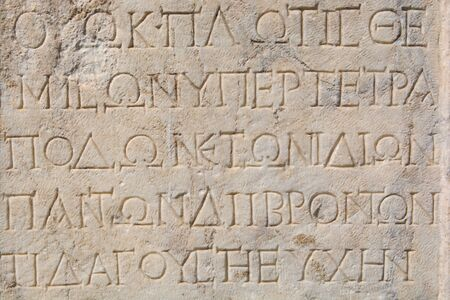 ancient greek written stone tablet. ancient greek alphabet