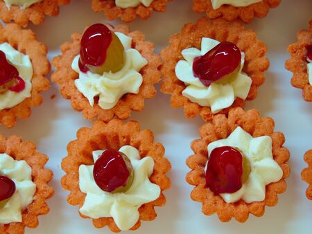 tartolet with cream grapes. mini desserts with fruit jelly. snacks