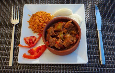 roasting meat in earthenware casserole. accompanied by