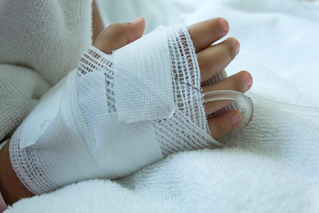 sickbed: Hand illness asian kids a sickbed, saline intravenous IV on hand
