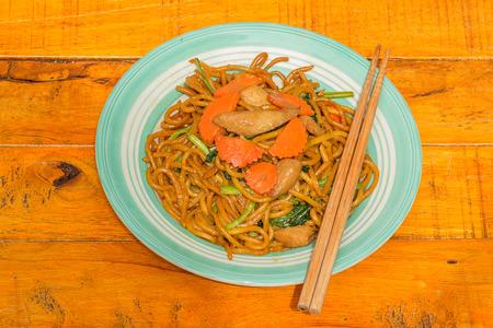 fried noodle: fried noodle on wooden background