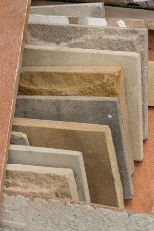 granite: stack of various granite marble tiles on ground