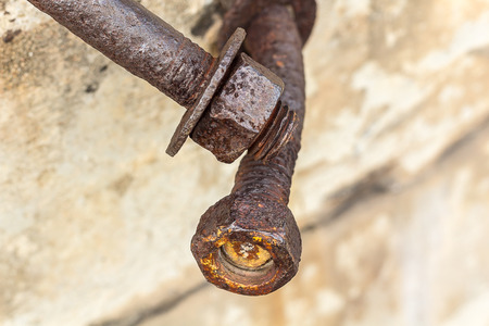 corrosive: Corrosive rusted bolt with nut. Grunge industrial construction close up.
