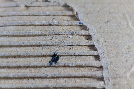 boxboard: Macro shot of ripped Cardboard texture