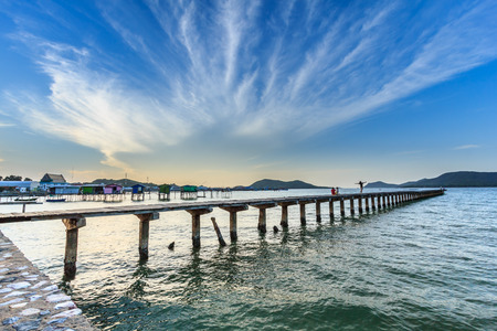 Beautiful sky and wooden bridge pier with twilight sky at morning time Stock Photo