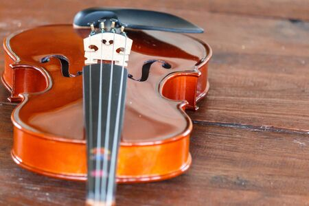 Close up of a violin shallow deep of field on wood background Stock Photo