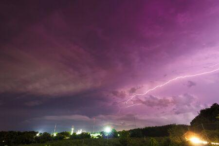 Storm and bright lightning strike at dusk at night 写真素材