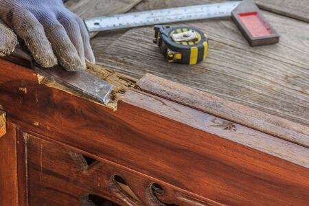 Close up the chisel to sharpen the wood plank