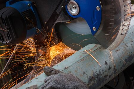 Close-up of Electric Grinder Cutting Metal with Bright Sparks
