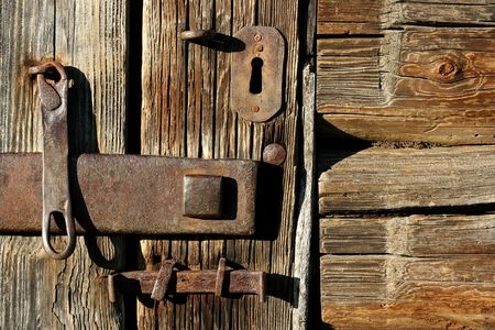 The old lock in a wooden door photo