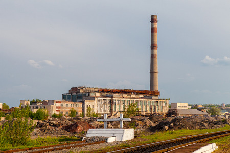 cement chimney: Damaged thermal power plant in Lisichansk, Ukraine Stock Photo