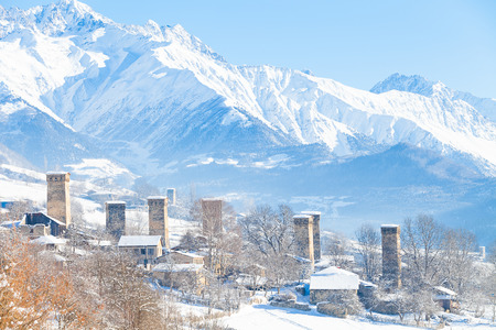 swanetia: Svan medieval village in the valley of the Caucasus Mountains. Clear sunny weather, winter.