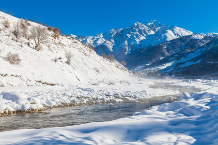 valley: River in a mountain valley in winter