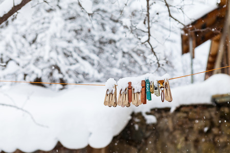 Clothespins on a rope under a snow photo
