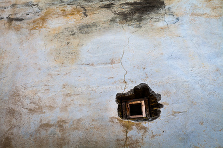 back yard: Small window in the old wall, loneliness and hope of the old town Stock Photo
