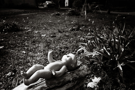 hopelessness: The lonely doll in urban scene, depression and hopelessness of life of urban suburbs