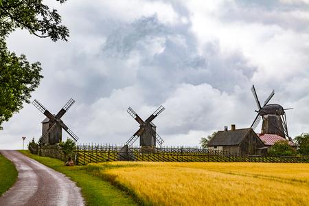 Old wooden windmills at farm on Estonian island Saaremaa