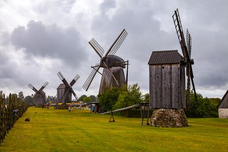 Angla, Saaremaa, Estonia - 01 of August 2015. Old wooden windmills at farm on Estonian island Saaremaa