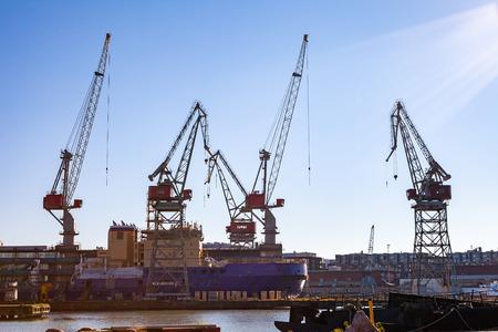 Harbor cranes in sea port of Helsinki, Finland. Stock Photo