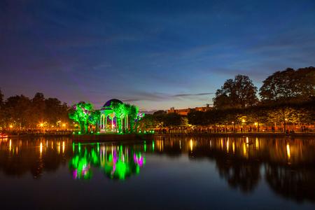 rotunda: Festival of lights in city park, pond with illuminated rotunda. Tallinn, Estonia