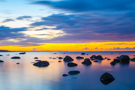 edge: Slow shutter seascape view dark stones in beautiful sunset