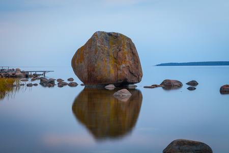 Big stone at Baltic sea at night