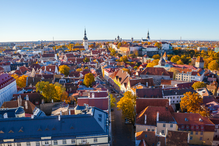 Classic panoramic view of full old Tallinn with towers, red roofs, churches and castle. Aerial view, autumn season Stock Photo