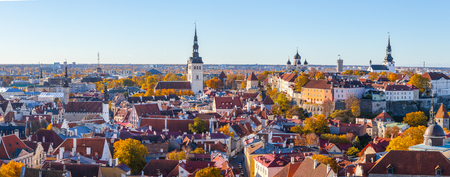 All the spires of old Tallinn - St. John Church, Town Hall, Niguliste church, Nevski Cathedral, Pikk Herman tower and Dome church. Towers and red roofs of old capital, Estonia. Aerial view, autumn season