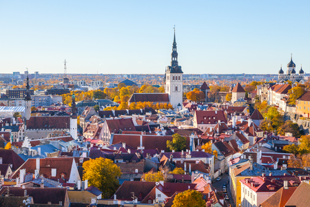 Town Hall, Niguliste church, Nevski Cathedral. Towers and red roofs of old capital, Estonia. Aerial view, autumn season