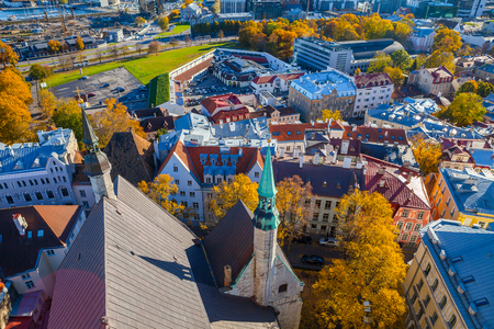 Roofs of old Tallinn from the highest Oleviste tower. Aerial view, autumn season