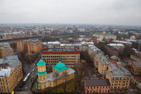 lutheran: RIGA, LATVIA - 25 DEC 2015. Annunciation of Our Most Holy Lady or St. Nicholas the Miracle Worker Church is one of the oldest churches in Riga. Aerial view, grey cloudy day.