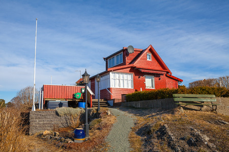 Red wooden cabin on the island, Norwegian style
