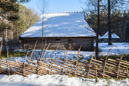 Traditional wooden cottage, baltic and scandinavian style. Winter scene in the countryside. Stock Photo