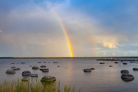 Rainbow over the sea and rocks, Kasmu, Estonia