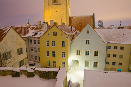 street lamp: Snow covered roofs of cosy medieval building in old town of Tallinn. Amazing winter view.
