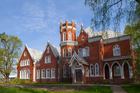 Old red brick castle at sunny day. Latvia.
