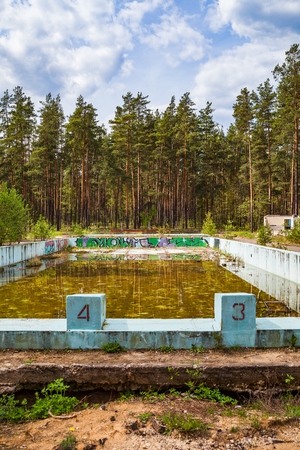 abandon: Abandoned overgrown outdoor swimming pool