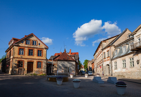 building a chain: Old town street and buildings. Cesis, Latvia. Stock Photo