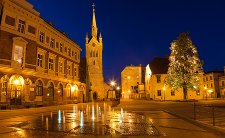 saint: Medieval church of Saint John and night old town view of Cesis, Latvia.