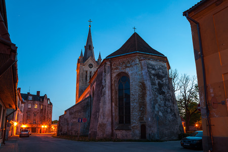 street lamp: Old town street and church at summer night. Cesis, Latvia