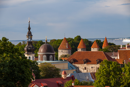 Red roofed towers of old Tallinn and Russian Orthodox church. Summer sunny day.