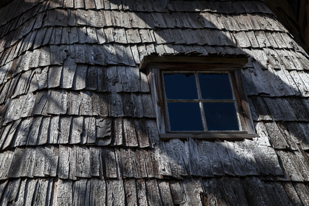 Old wooden windmill tower roof with small window Stock Photo