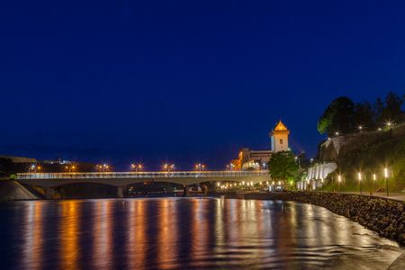moderm: Illuminated medieval fortress and moderm bridge on the river Narva, Estonia and Russia border. Blue hour