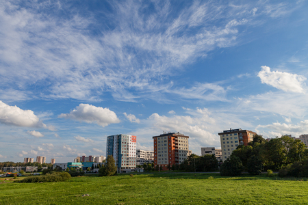 balcony: New modern blocks of flats in green area with blue sky at summer day. Northern friendly style.