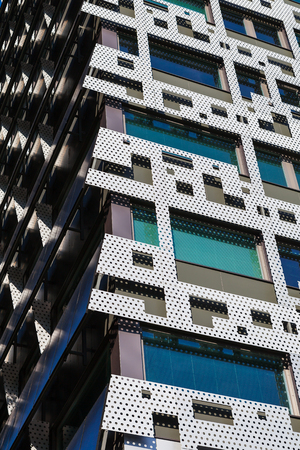 Mosaic of metal sheets is a part of modern design of skyscraper. Steel and glass structures.