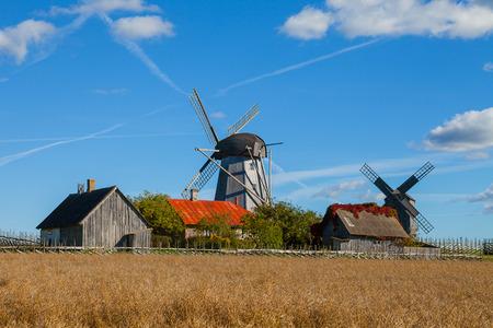 Traditional wooden windmills of Saaremaa island, Estonia. Sunny autumn day. Фото со стока