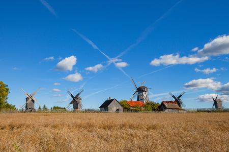 Traditional wooden windmills of Saaremaa island, Estonia. Sunny autumn day. Stock Photo